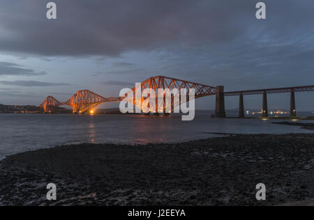 Forth Bridge at dusk looking north, South Queensferry, Lothian, Scotland, United Kingdom - Stock Photo