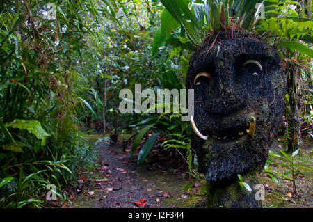 Wooden mask in a tribal village in the highlands of Papua New Guinea, Papua New Guinea - Stock Photo