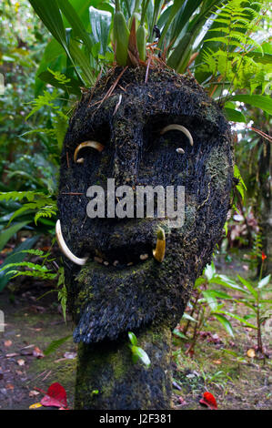 Wooden mask in a tribal village in the highlands of Papua New Guinea - Stock Photo