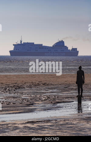 Another Place Antony Gormley Crosby Beach Statue - Stock Photo