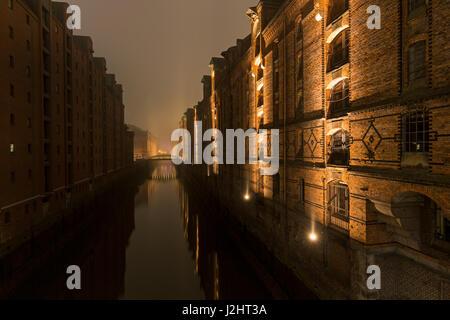 Historic Speicherstadt warehouse district at night, HafenCity, Hamburg, Germany, Europe - Stock Photo