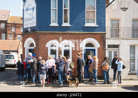 Aldeburgh Suffolk UK, 29th April 2017. People queue for fish and chips outside the famous Aldeburgh Fish and Chip - Stock Photo