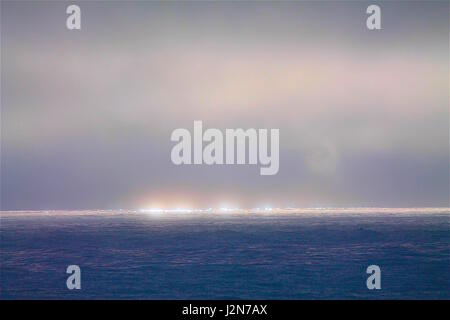 Overcast Skies at Sea during Sunset - Stock Photo