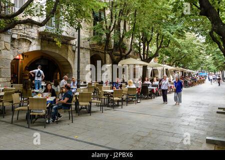 Tree shaded cafes along Rambla de la Llibertat street in the old town of Girona, Catalonia, Spain - Stock Photo