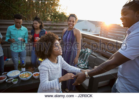 African American father and daughter dancing on deck - Stock Photo