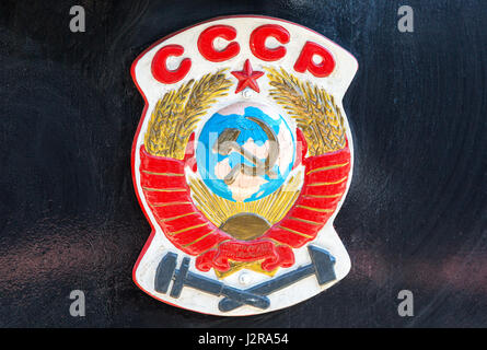 Symbol of former state the USSR on the retro steam locomotive - Stock Photo
