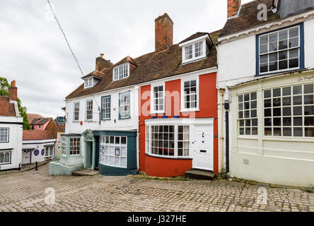 Cobbled Quay Hill with picturesque quaint local historic buildings leading to Quay Street and harbour at Lymington, - Stock Photo