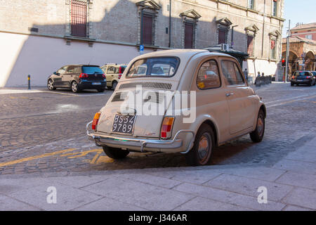 Old car Fiat 500 in the street in Italy - Stock Photo