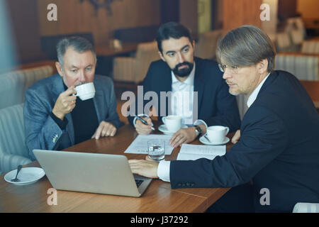 Working on Business Presentation with Colleagues - Stock Photo