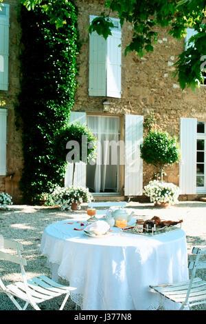 Alfresco dining set up. - Stock Photo