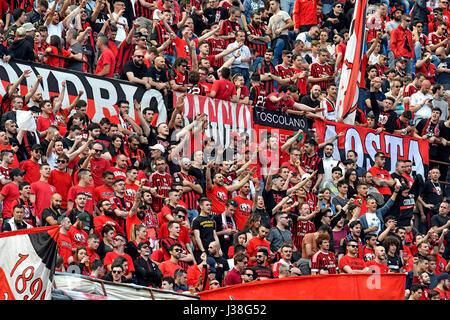 AC Milan Soccer fans at the san siro stadium, in Milan, Italy. - Stock Photo
