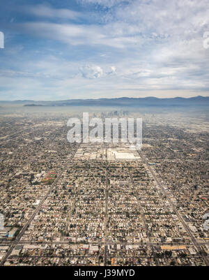 A sweeping aerial shot of Los Angeles showing symmetrical rows of buildings and roads leading into downtown. - Stock Photo