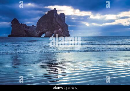 Archway Islands on the beach at Wharariki Beach near Nelson, New Zealand - Stock Photo