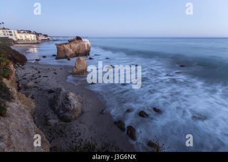 Dusk view of El Matador State Beach surf in Malibu California. - Stock Photo