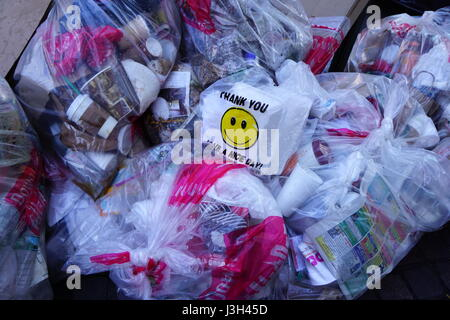 A pile of garbage in plastic bags - Stock Photo