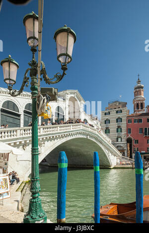 Spring afternoon at Rialto Bridge in Venice. A view from San Polo district. - Stock Photo