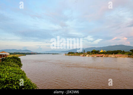Natural landscape of Mekong River is a muddy color during sunset at Golden Triangle Park (Sob Ruak) is the border - Stock Photo