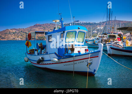 Fishing boat in the harbor on the greek island of Patmos - Stock Photo