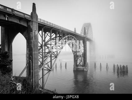 The Yaquina Bay Bridge is an arch bridge that spans Yaquina Bay south of Newport, Oregon. It is one of the most - Stock Photo