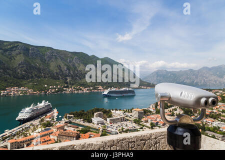Looking down on the coastal town of Kotor in Montenegro, located in a secluded part of the Bay of Kotor - surrounded - Stock Photo