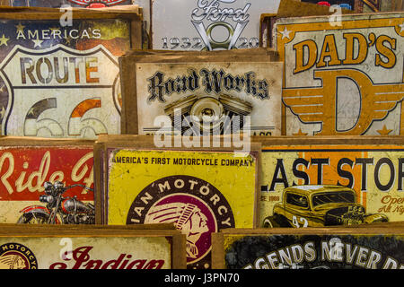STUTTGART, GERMANY - MARCH 03, 2017: Background of vintage advertising signs. Europe's greatest classic car exhibition - Stock Photo