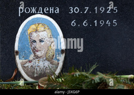 Photograph of Soviet civilian Vera Stepanova on the ground of the Soviet War Memorial at the Central Cemetery in - Stock Photo