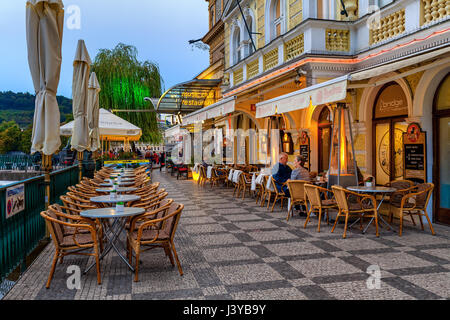 PRAGUE, CZECH REPUBLIC - SEPTEMBER 22, 2015: People sitting on restaurant terrace in Prague - capital and largest - Stock Photo