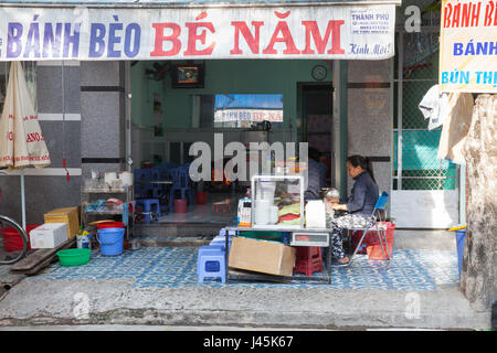 NHA TRANG, VIETNAM - DECEMBER 18: Vietnamese woman are selling food on the street on December 18, 2015 in Nha Trang, - Stock Photo