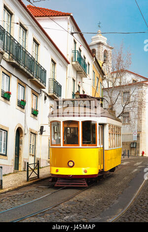 Yellow 28 tram in Alfama, Lisbon, Portugal - Stock Photo