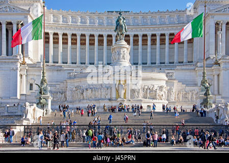 Altare della Patria or Monumento Nazionale in Rome Roma with crowds of tourists on a sunny day with blue sky. - Stock Photo