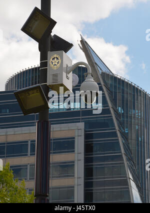 A police security camera keeps watch over Klyde Warren Park in downtown Dallas, Texas. - Stock Photo