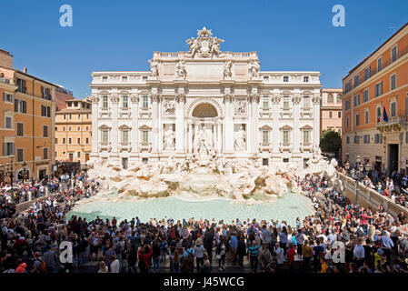 An aerial view of The Trevi Fountain 'Fontana di Trevi' in Rome with crowds of tourists and visitors on a sunny - Stock Photo