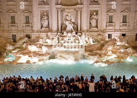 An aerial view of The Trevi Fountain 'Fontana di Trevi' in Rome with crowds of tourists and visitors at night. - Stock Photo