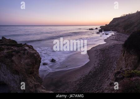 Early evening view of El Matador State Beach in Malibu California. - Stock Photo