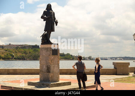 Couple watching to the monument of Pierre Le Moyne D'Iberville in Havana, Cuba - Stock Photo