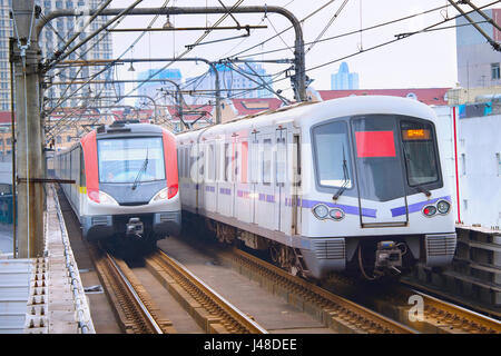 Metro trains on a rails in Shanghai in the day. China - Stock Photo