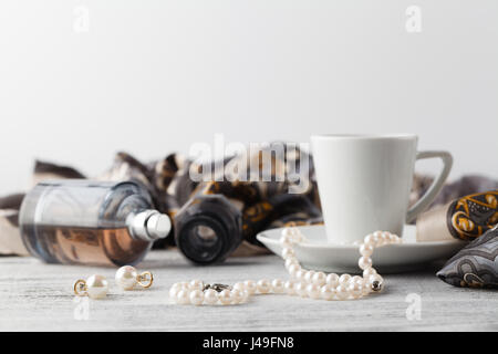 Breakfast in cafe with coffee cup and scarf on table - Stock Photo