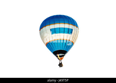 A Brightly Coloured Hot-Air Balloon Flying Over a Garden in Alsager Cheshire England United Kingdom UK - Stock Photo