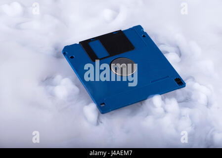 Blue floppy disk. Retro and old fashioned - Stock Photo
