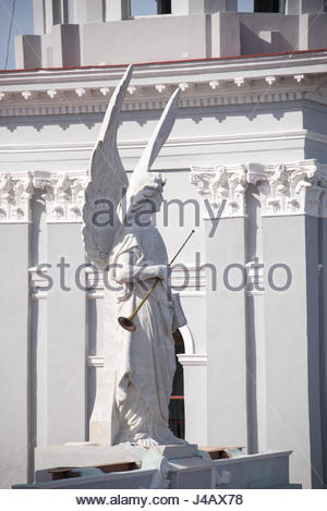 Our Lady of Assumption Catholic cathedral church in the traditional Santiago de Cuba city. Statue of Angel with - Stock Photo