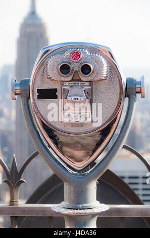 Tourist binoculars overlooking the Manhattan skyline in New York City - Stock Photo