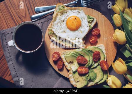Breakfast variations. Avocado on a toasted bread. - Stock Photo