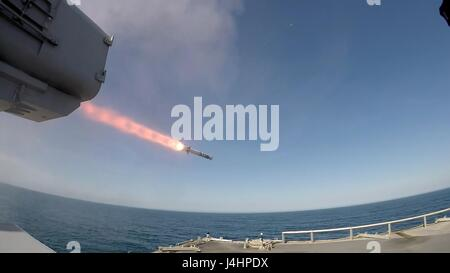 The USN Independence-class littoral combat ship USS Jackson fires a SeaRAM test missile at an aerial drone April - Stock Photo