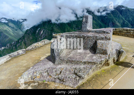 Intiwatana observatory rock in sacred city of Machu Picchu - Stock Photo