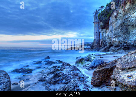 Dark skies over the pirates tower turret after sunset at Victoria Beach in Laguna Beach, California, USA - Stock Photo