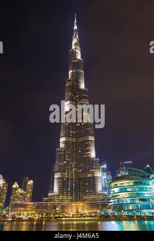 DUBAI, UAE - MARCH 24, 2017: The nightly Burj Khalifa and the fountain. - Stock Photo