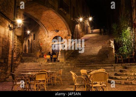 Girona city by night, Pujada de Sant Domenec stairs and Arch of the Agullana Palace, Catalonia, Spain - Stock Photo