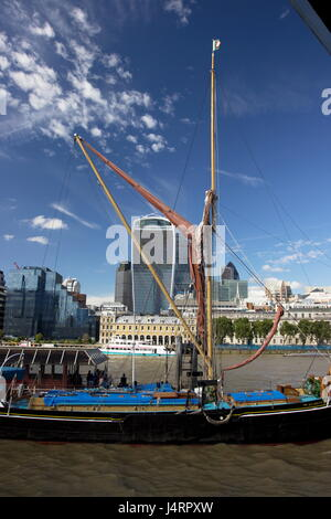 Spritsail Barge Gladys is part of the National Historic Fleet certificate 204 and was built in 1901 in the background - Stock Photo