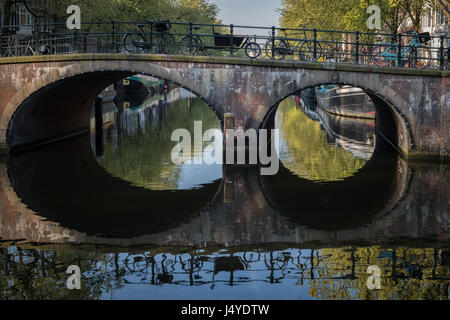 Bicycles reflected in the Brouwersgracht canal, Amsterdam - Stock Photo