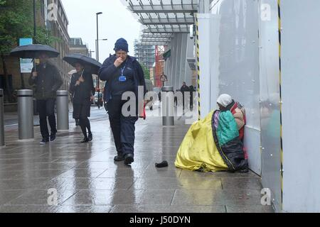 London, UK. 15th May, 2017. Homeless man next to The Shard at London Bridge station. :Credit claire doherty Alamy/Live - Stock Photo